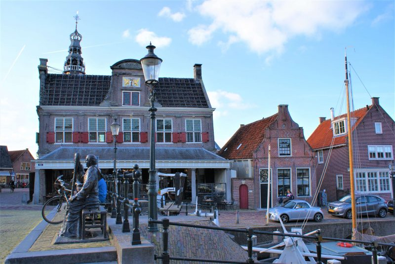 The weighhouse of Monnickendam with a statue of