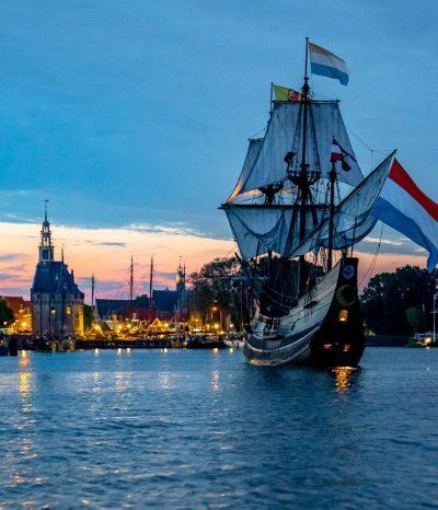 The Halve Maen, a replica of a 17th century merchants ship, sails at dawn through the harbour of Hoorn.