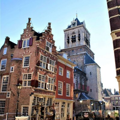 Delft is one of the 12 cities wich are to be reached within one hour from Amsterdam. It lies in the in southern part of our country. On the picture you see a shop with a beautifull stepped gabel, the oldest facades we know. Behind it you see the cityhall of Delft.